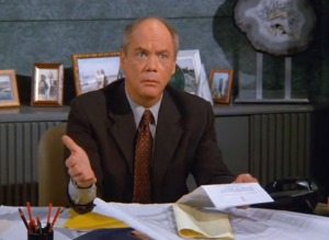 Daniel Von Bargen, wondering why George would ever try and give him a fake Christmas gift.