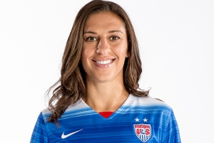 A very happy Carli Lloyd, who will spend the next three years installing carpets in strangers homes.