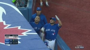 Members of the Blue Jays pleading with Philadelphia fans to stop their barrage of beer bottles.